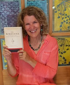Linda Egenes holding her latest book